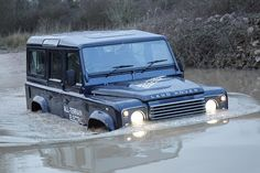Land Rover Defender in Deep Water. Looks good, but a bit silly without a snorkel unless you've walked across first and know the depth.