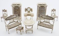 Scoop - Where the Magic of Collecting Comes Alive! - Noel Barrett Offers Jacobs Dollhouses, Miniatures |  Leonhardt Parlor Suite, early 20th century, white painted wood with floral silk upholstery and gilt edging. Est. $800-$1,200.