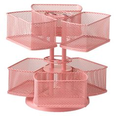 Rotating cosmetics carousel in pink.     Product: Cosmetic carouselConstruction Material: MetalColor:...