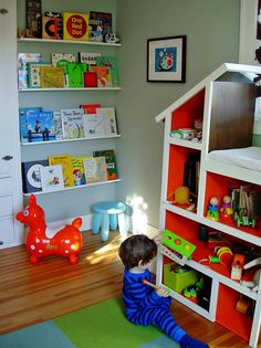 Modern kids room ... LOVE the book shelves and the dollhouse-made-into-shelving/changing table