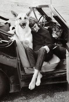 The writer Francoise Sagan and a German shepherd.