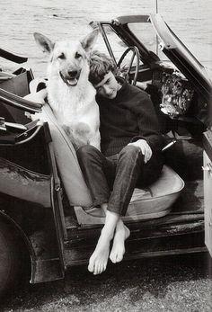 The writer Francoise Sagan and a German shepherd.