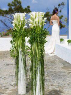 Steel grass, ruscus and standard calla lilies.