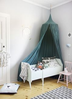 A beautiful petrol blue bed canopy and love the mix of blue with soft pink