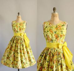 Vintage 50s yellow floral cotton dress with matching yellow waist tie. Full skirt. Metal zipper up back. Crinoline worn underneath skirt in