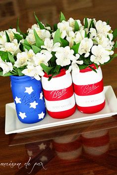Think flowers are too feminine for your Fourth of July party? What if we said you could fill these DIY painted Mason Jars with your favorite Southern Comfort cocktail? I thought you'd reconsider.