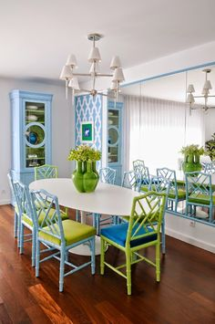 Complement a green set of dining room chairs with a matching green vase for an eye-catching table centerpiece.