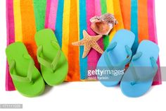 171111035-candy-stripe-beach-towel-with-flip-flops-gettyimages.jpg (507×338)