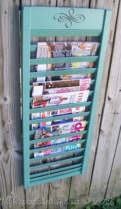 repurposed shutter into magazine rack. Ideal for the bathroom readers. : )