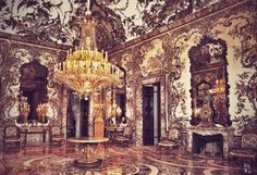 Gasparini room - the Royal Palace of Madrid Charles III used this room for both receiving guests and as a dressing room. The amount of work required to complete this room was so enormous it was not done until 14 years after Charles III's death.  Decorated in the Baroque style, the room's walls are covered in silk with gold and silver embroidery. http://icollectcastles.com/post/86904470073/spanish-art-and-decadence-the-royal-palace-of-madrid
