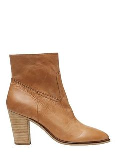 Suede side zip ankle boot with mid height stacked heel. Leather upper with manmade lining and sole.