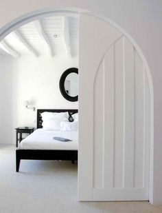 Arched pocket door, great for making a room into a guest bedroom or separating the master.