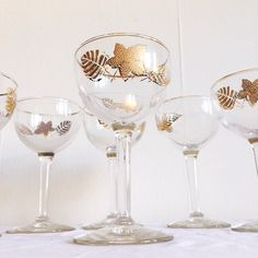 Excited to share this item from my #etsy shop: VINTAGE | set of 6 mid century 22K gilded leaf coupe glasses #demarsvintage