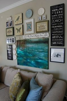 Love gallery walls by soulouttaki combo b/w, neutral prints, signs, and bright canvas photo. if a tv was super thin and wires hidden, then you could donwith tv. are screensavers for   newer TV?