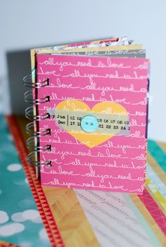 love is all you need - Scrapbook.com - Sweet little mini album made with Echo Park paper and bound with the Zutter Bind it All.