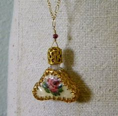 Love a vintage perfume bottle... especially on a necklace for your maid of honor.