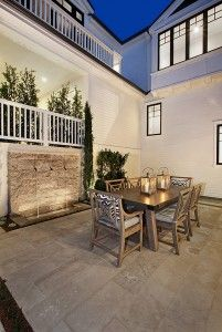Patio with garden water features. Patio outdoor dining. #patio  Spinnaker Development.