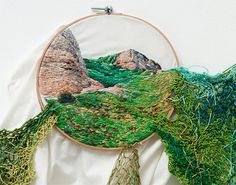 Artist Ana Teresa Barboza, born in Perú, creates embroidered nature landscapes made of yarn and wool which spill out of their traditional wooden frames. The works imitate the fluid looks of waves and growing grass through the color palette which give them slightly a 3D-effect.Barboza's work is an example to the movement of extracting the art into the gallery space, called the pop-up generation, which we have seen for the last years.