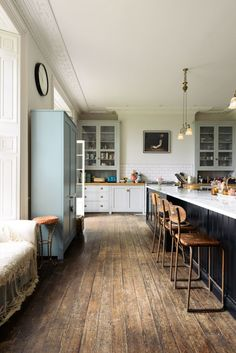 The floors are original to the country house, and the walls are painted in Farrow & Ball's Strong White.
