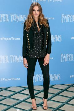 At the London photocall for Paper Towns, Cara Delevingne channelled rock'n'roll chic in a starry Saint Laurent blouse and cropped jacket. Beachy ringlets and smoky eyes completed her look - June 18, 2015