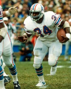 Photo about Former Houston Oilers legend Earl Campbell (Image taken from color slide. Image of football, league, pigskin - 42032956 Nfl Football Players, Football Stadiums, Football Helmets, Sport Football, Earl Campbell, Tennessee Titans Football, Nfl 49ers, Houston Oilers, Football Conference