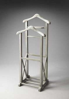 Riley Valet Stand Artifacts - 1884290. This Valet Stand, crafted from select solid woods and wood products, is as fashionable as it is functional in our Gray Dawn finish with the X-shaped lower side supports descending to the base anchored by four roads. It features a place to hang a coat, a shirt, pants and ties as well as a tray for keys, wallet, watch, pocket change and cufflinks.