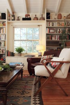 Love the whole feel of this room - could stay curled up in that big leather chair with a book and a cup of tea!