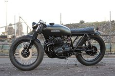 Salty Speed Co CB400 - Micah from Melbourne, Australia spent a year at Bible School on the South Pacific island of Venuatu with a $500 CM185 as his sole transport. The two-wheeled flame that had been burning since childhood was reignited and Micah scoured the web looking for his dream machine. Salty Speed Co. and their #2 CB400F build got Micah's heart racing enough to put in an order, the brief; black brat....