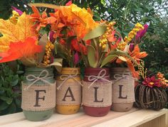 A Midnight Owl Original!! Decorative Set of 4 Hand-Painted Ball Mason Jars in our own unique Fall themed colors ready to be placed in your beautiful Fall setting! This set makes the perfect centerpiece or mantle piece! This set includes 4 pint size (16 oz.) jars, beautifully painted and then carefully distressed for that rustic look we all love! We then seal each jar with a matte sealant and then finish off with a jute twine bow. Burlap is wrapped around each jar, spelling out the word Fall…