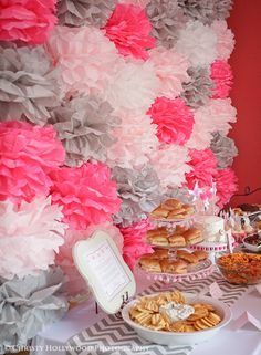 Tissue pompoms make a fab backdrop to a fun party table!
