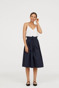 60653eb815788 Dark blue. Calf-length skirt woven in a cotton blend with pleats at the