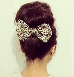 i just love the idea of adding a big bow at the bottom of a bun.