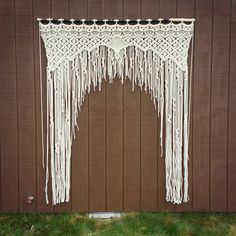 This is for a made to order macrame arch, handmade by me using 100% natural cotton rope. Would work wonderfully as a wedding backdrop, window curtain, room divider, doorway curtain, or even just hang it on your wall!  Macrame pictured (example only) measures approx 8 tall and 59 wide. I can adjust width and length for you as needed. Price will vary with size so please message me before ordering if you would like a different size. Price listed is for an item of this size, made to be hung…