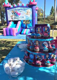 Frozen Birthday Party Ideas, homemade cupcake tower and Frozen jumper