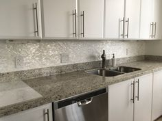 Amazing backsplash using White Brick Groutless Pearl Shell Tile, so serene!