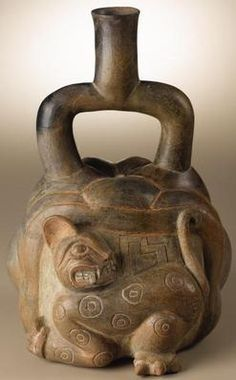 ancient peruvian pottery | ceramic Pre-Columbian stirrup-spout vessel with relief carved feline ...