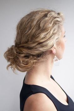 Messy twisted bun for curly hair. Get the how-tos.