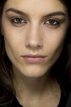 Contoured eyes in a taupe shade, drawing black liner into the waterline of the eyes at Emilio Pucci Fall/Winter 2014-15