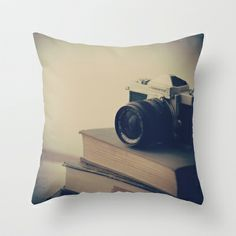 Vintage Nikon Camera and Old Books Throw Pillow by AC Photography - $20.00