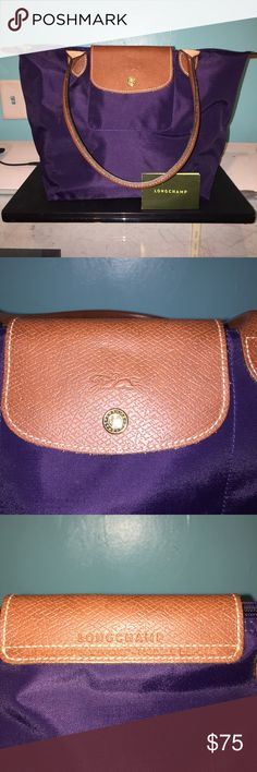 Longchamp tote Looks fantastic! Purple in color- foldable, the inside is water repellent. Longchamp Bags Totes