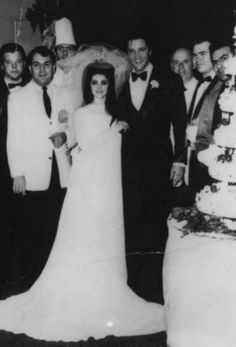 Elvis and Priscilla with the staff at the Aladdin Hotel.