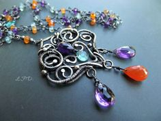 Wire Wrapped Sterling Silver Necklace With by LovePotionDesign. €250,00, via Etsy.