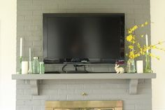 Wooden mantel for under a wall mounted tv - hide cords, store electronics  provide decor focal.