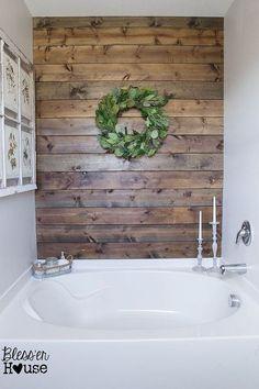 DIY Rustic Bathroom Plank Wall Has two coats of marine grade polyurethane to protect it.
