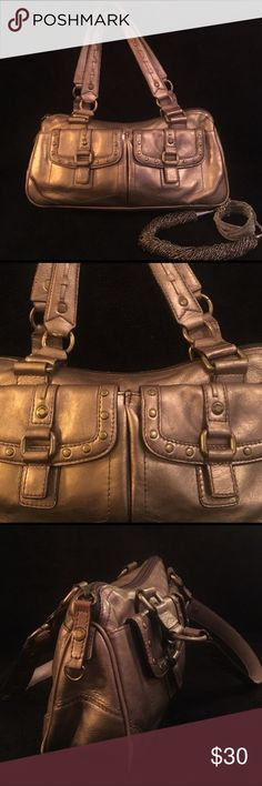 3db72e86380 This bag is gently used in overall good condition with normal wear. The  bottom has some minor peeling but not noticeable.