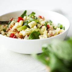 Corn Basil Quinoa Salad. Made with roasted red peppers and a lemon vinaigrette. Makes a wonderful summer salad.