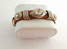 A personal favorite from my Etsy shop https://www.etsy.com/listing/219523003/organic-cuff-leather-bracelet-vintage