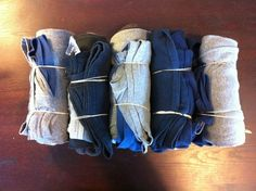 Roll up your clothes in bundles and secure them with elastics. | 22 Easy Tricks To Make Packing So Much Better