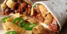 CHILI CHEESE FRITO BURRITO WITH GREEN CHILI QUESO
