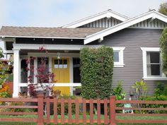 Blue grey house, white trim, yellow door.